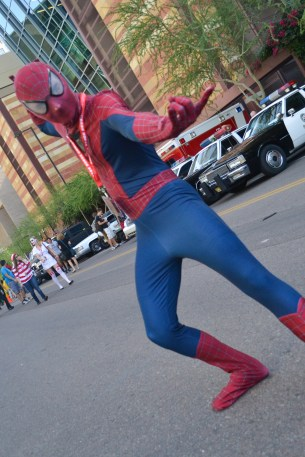 Raymond Kubiak gets ready to shoot a spiderweb at Comicon in downtown Phoenix Saturday afternoon.