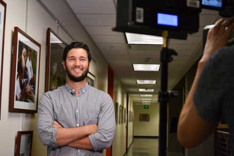 Dominic Valente gets ready to do an interview during the Greg Photojournalism Award Ceremony at the Cronkite School Of Journalism in downtown Phoenix on October 5, 2015.