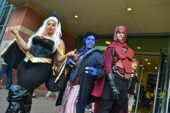 Charlise Mason (left), Rebecca Harrington (middle), and Brad Smith (right) show their X-men costumes at Comicon in downtown Phoenix Saturday afternoon.