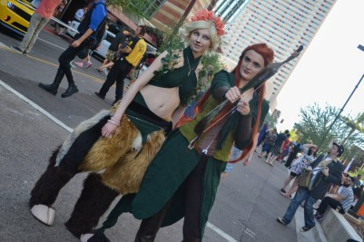 Alex Goodspeed (left) and Savannah Wilson (right) get ready to get their picture taken at Comicon in downtown Phoenix Saturday afternoon.