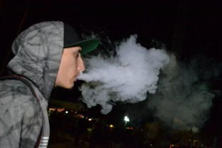 People enjoy vaping at First Friday in downtown Phoenix on November 6, 2015.