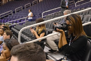 Jahnez Wong (right) takes pictures of the Phoenix Mercury practice during the Summer Journalism Program on June 9, 2015.