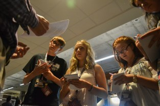 Samuel Brennan (left), Ericka Patti (middle), and Danielle Malkin (right) take notes during an interview excercise while in the Summer Journalism Program on June 4, 2015.