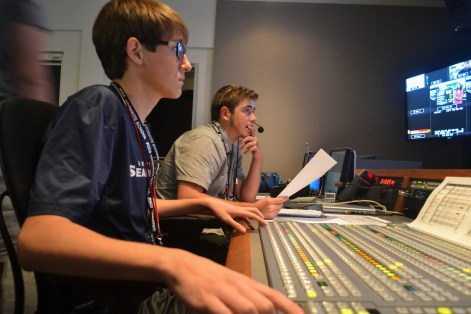 Samuel Brennan (left) and Daniel Gorman (right) run the controls for the news segment during the Summer Journalilsm Program on June 10, 2015.