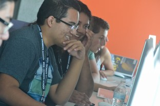Agustin Lopez (left) and Pilar Cota (right) have fun while learning how to use Adobe Premiere during the Summer Journalism Program on June 2, 2015.