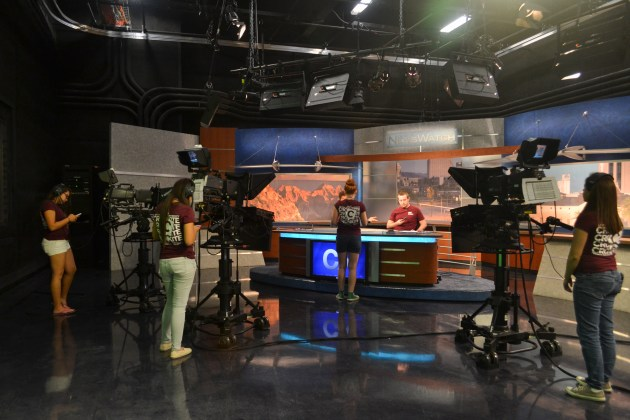 The students get ready to do a practice runthrough during the Summer Journalism Program on June 3, 2015.