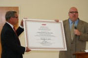 AARP NY Associate State Director Bill Armbruster presenting Age-Friendly certificate to Chemung County Executive Tom Santulli