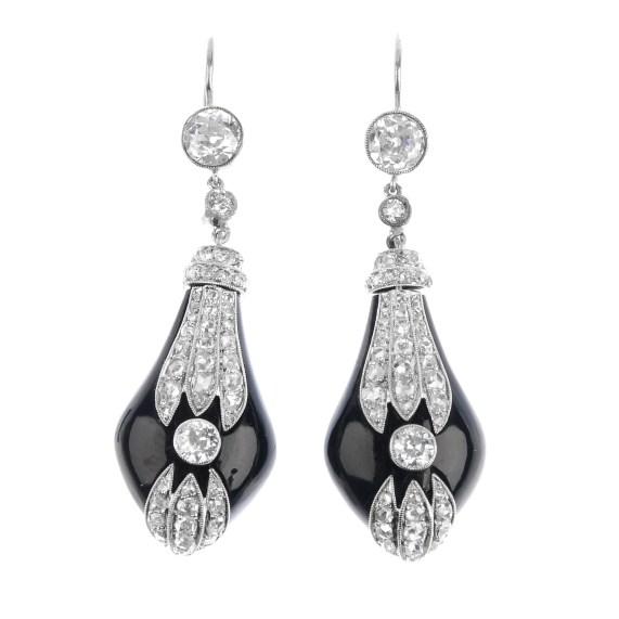 A pair of Art Deco diamond and onyx earrings.
