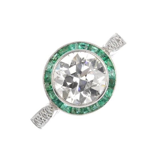 A platinum diamond and emerald cluster ring.