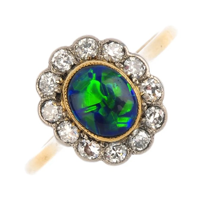 Lot 79 A black opal and diamond cluster ring.