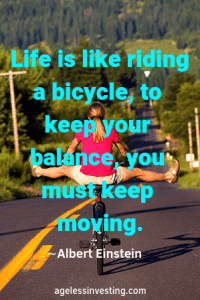 """A woman riding a bicycle down hill with her legs in the air,. quote """"Life is like riding a bicycle, to keep your balance, you must keep moving Quotes about moving forward"""" by Albert Einstein,"""