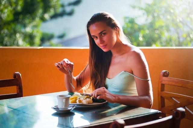 A woman eating healthy food