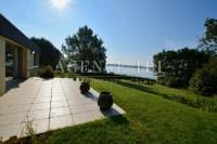 840- TBI- Maison pleine vue mer les pieds dans l'eau à Baden sur parc paysager