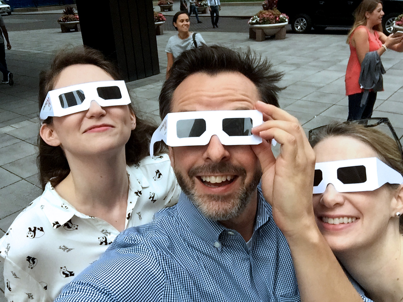 employees looking at the solar eclipse in chicago