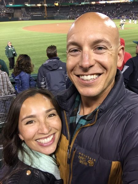 A couple smiling at a ball game