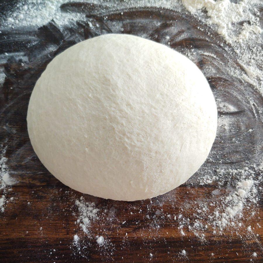 Dough manipulated in a ball shape