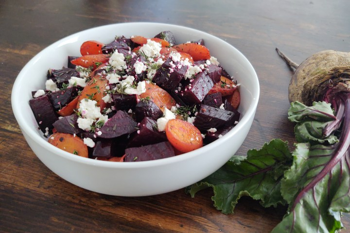 Up close of beets and carrots with feta and thyme with raw beet adjacent