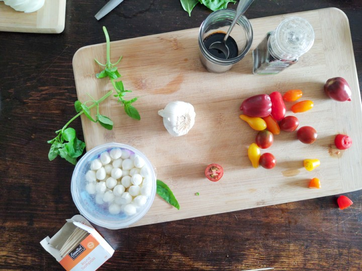 Prep of tomatoes, cheese for Caprese Salad Summertime Appetizer