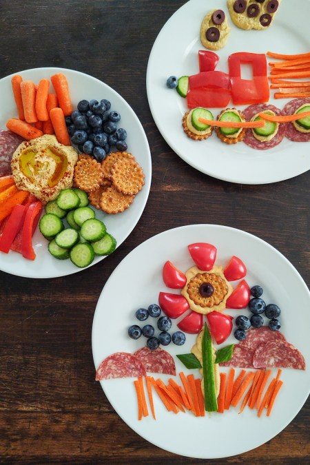 A trio of plates with different ways of displaying hummus and vegetables