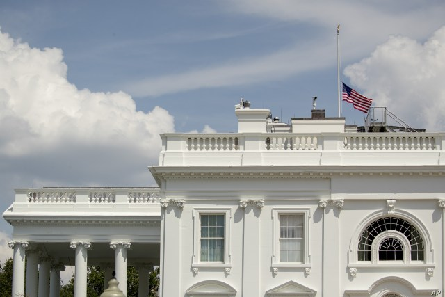 The American flag flies at half-staff at the White House in Washington, Aug. 4, 2019, to honor those killed in two mass shootings, one in Dayton, Ohio, and one in El Paso, Texas.