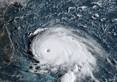This satellite image obtained from NOAA/RAMMB shows tropical storm Dorian as it approaches the Bahamas and Florida at 12:00 UTC.