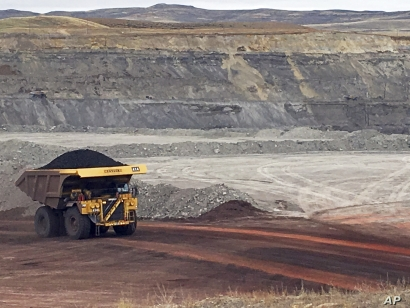 FILE - In this March 28, 2017, file photo, a dump truck hauls coal at Contura Energy's Eagle Butte Mine near Gillette, Wyo. Mine owner Blackjewel LLC of Milton, W.Va., says it has filed for Chapter 11 bankruptcy protection. Blackjewel operates mines…