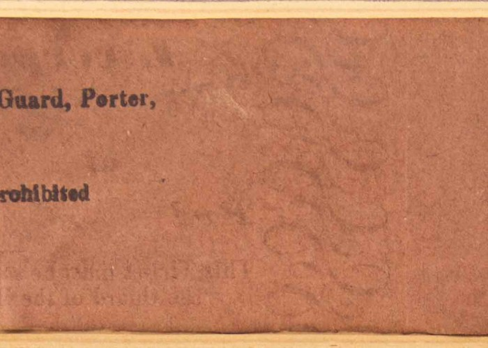 A high resolution image of the back of an old train ticket from Liverpool to Warrington. The ticket is a faded brown colour with black ink