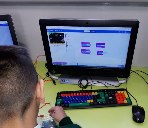 student using coding software