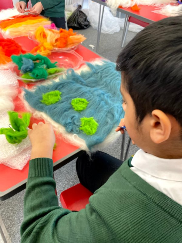 students creating handmade felt protest banners