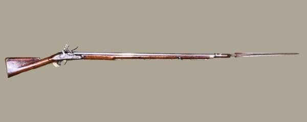 a wooden gun with long barrel