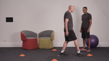 Gus Falcioni (left) has a history of knee injuries and provided feedback to Nirtal Shah (right) as the app was developed.