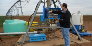 Dr. Charles Hillyer, AgriLife Extension irrigation engineering specialist in Amarillo, runs a test on the variable rate irrigation pivot system at Bushland as part of the Precision Ag Irrigation Leadership project. (Texas A&M AgriLife Communications photo by Kay Ledbetter)