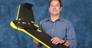 Dr. Michael Starek, assistant professor of geospatial surveying engineering at Texas A&M-Corpus Christi, holds a  Sensefly eBee UAV, the type to be used in agricultural research at the Texas A&M AgriLife Research and Extension Center at Corpus Christi. (Photo courtesy of Texas A&M-Corpus Christi)