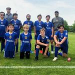 Steve Moubray and Rik Popat coaching youth soccer