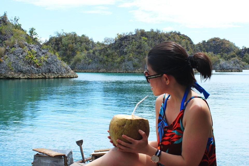 girl drinking coconut water in digital detox trip