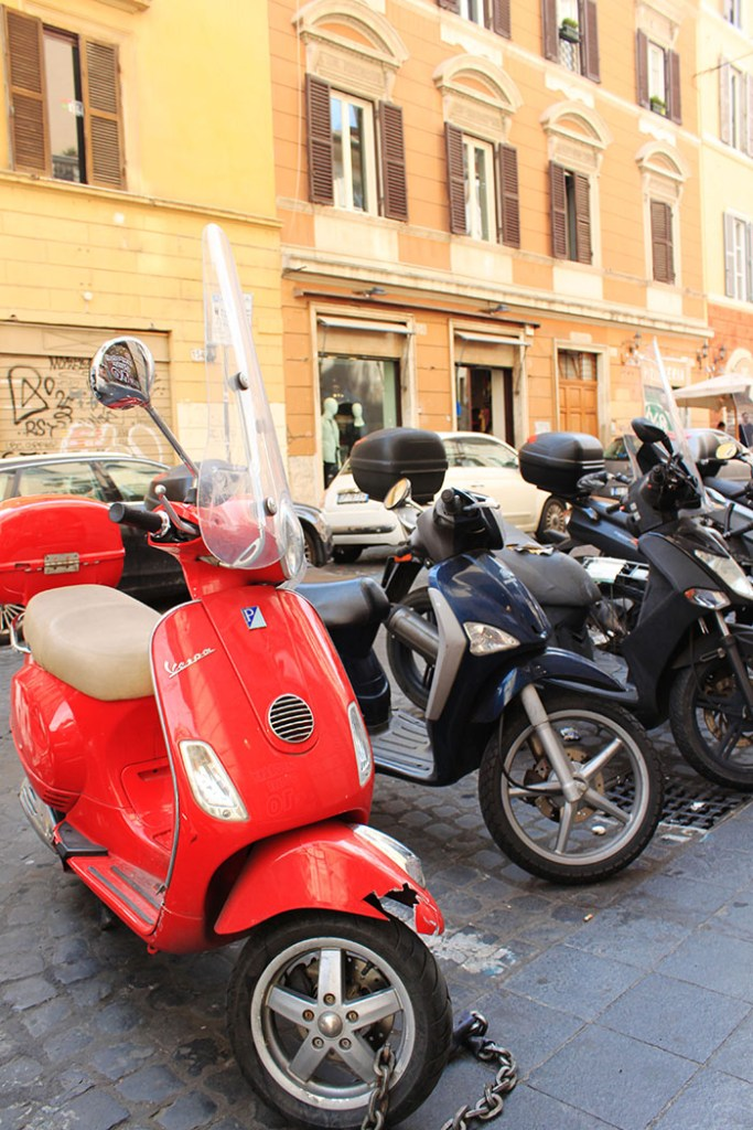 globetrotters in rome with red vespa