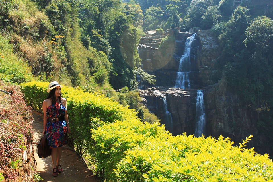 woman posing at ramboda waterfall sri lanka lonely planet hottest destination 2019