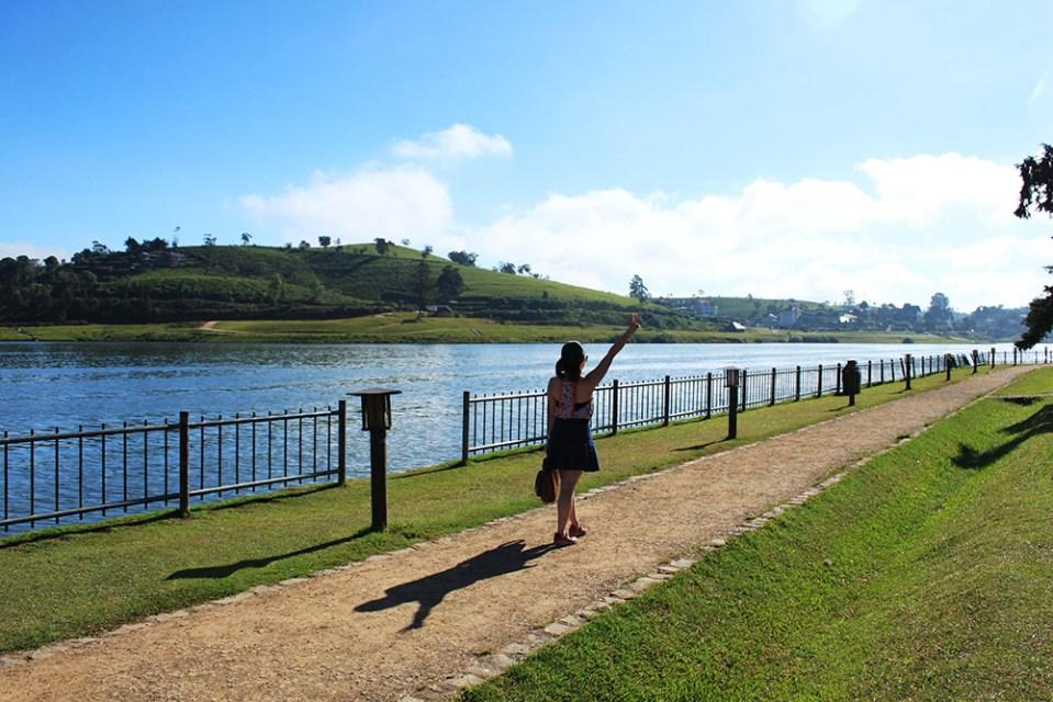 female solo traveler walking alone at gregory lake nuwara eliya sri lanka