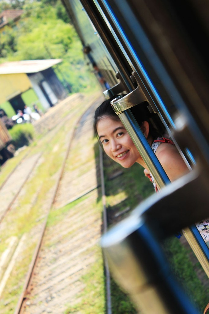 female traveler on ella kandy train ride sri lanka