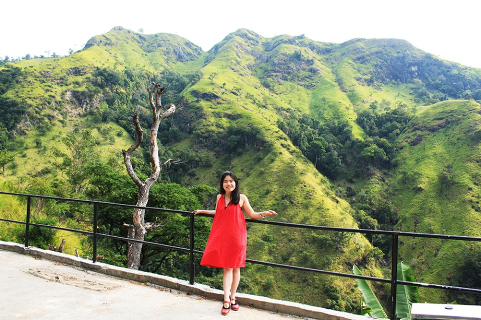 girl in red dress at little adam's peak sri lanka lonely planet hottest destination