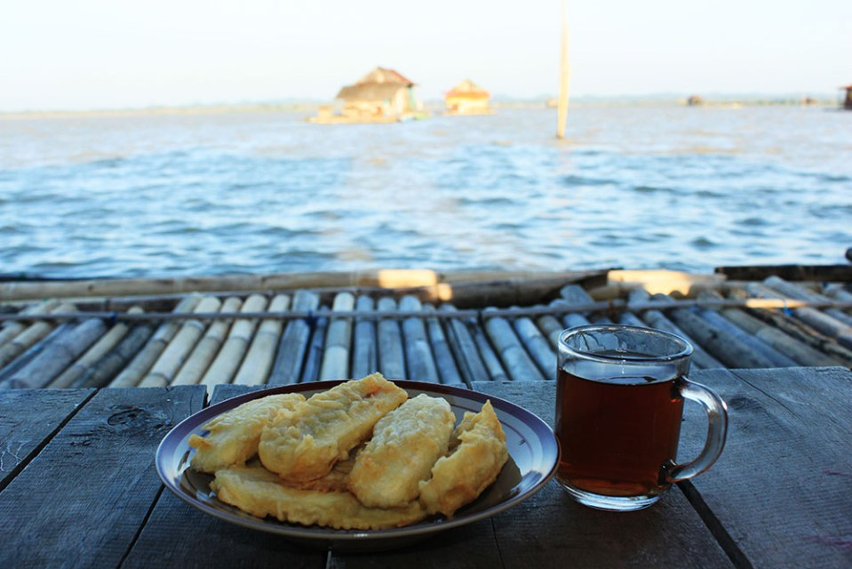 tea time at floating houses tempe lake indonesia with banana fritters and hot tea