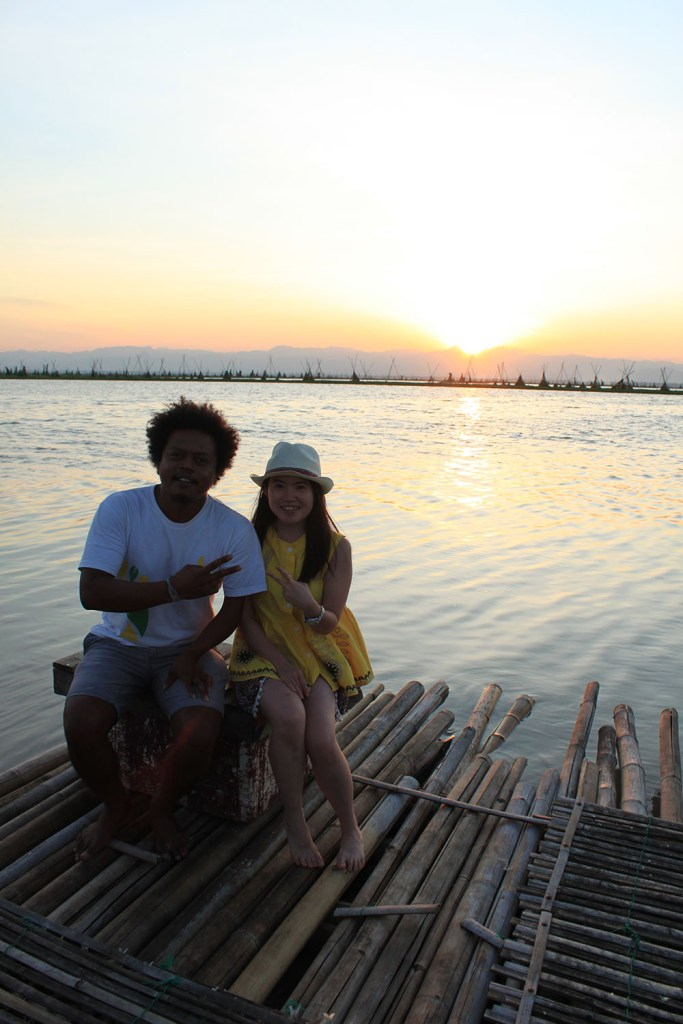 friends posing during sunset at floating house tempe lake indonesia