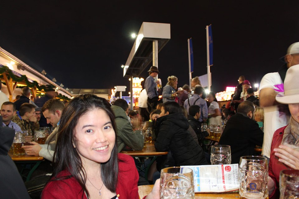 female wanderlust drinks beer  in the road less traveled oktoberfest