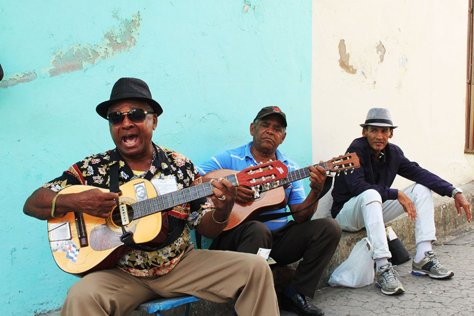 vintage street musicians in cuba playing guitar and singing