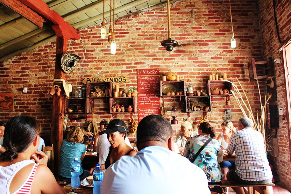 travellers flocking at Meson La Cuchipapa, a food survival guide in Cuba