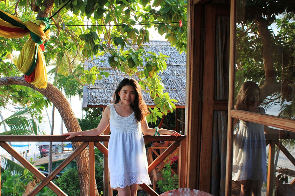 a girl posing in BaraCoco Bungalows in sundress during summer beach holiday