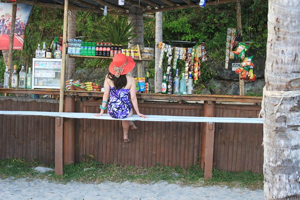 girl in vintage swimsuit posing at the bar in Tanjung Bira near BaraCoco Bungalows