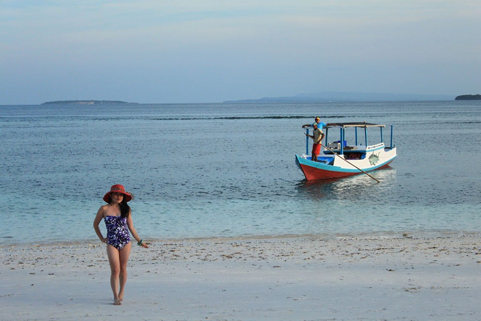 a girl in swimsuit posing at Tanjung Bira beach during summer stays in BaraCoco Bungalows