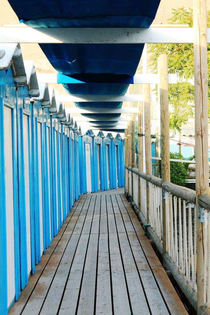 Blue deck in Sorrento beach, Italy summer