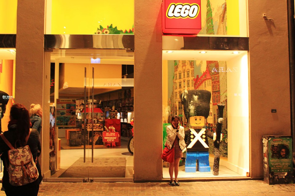 A happy girl in front of Lego Store in Copenhagen, Denmark